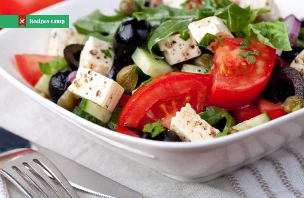 Recipe  Marinated Cheese-Topped Salad