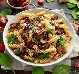 Pasta with homemade pesto from sun-dried tomatoes