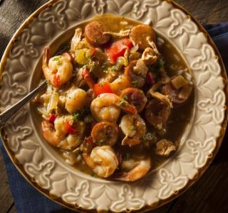 Sausage, Shrimp and Peppers over Cheesy Grits