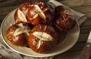 Caramelized Onion Pretzel Rolls with Caraway Salt