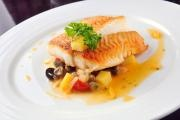 Sea bream with lemon sauce and olives